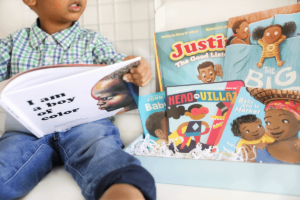 toddler boy with book